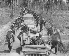 US marines with Japanese prisoners of war during the Pacific Campaign of World War Two, Guam, circa 1943-1945.
