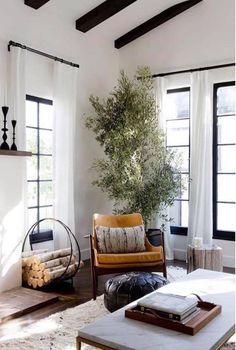 chair corner nook window plant wooden stump table