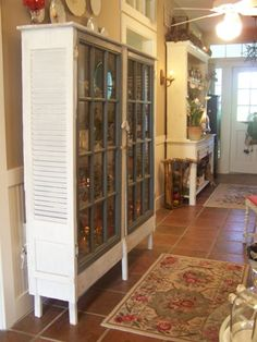 Great homemade piece--old shutters and old windows repurposed.   I need this except with frosted glass or even a bright fabric instead of clear glass so I can hide TOYS!