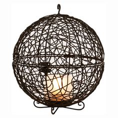 We have some wicker lanterns very similar to this with a tall colored center that is actually a lamp!   Center comes in pink, green, orange, and blue...