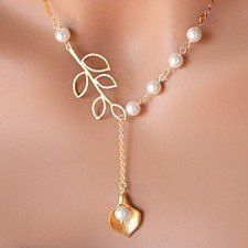 """Simply adorable! A pearl hanging from a lariat style chain with branch leaf connector.Necklace can be adjusted in length by simply pulling the tear drop pearl according to desired drop length and style.Available in white gold plated chain, yellow gold plated and Rose gold Platedwith your choice of 18, 20 or22-inchchain. Each chain comes with a 2"""" extender.Freshwater pearlsLobster clasp closureLead/nickel freeComes in a pouch or box ready for gift giving!"""