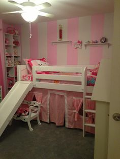 pink and white stripes add a modern look to a hello kitty bedroom