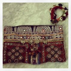 Colorful hand-embroidered pouch. Mirror and coins. By Muzungu Sisters