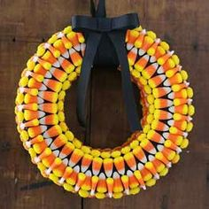 Dollar Tree Craft Candy Corn Wreath  Need: Foam Floral Ring Two or Three 8-oz. Bags of Candy Corn Two 5-yard Spools of Black Grosgrain Ribbon Glue Scissors Easy Step-by-Step Directions:  Wrap the entire floral ring with black ribbon (see image below). Use glue to hold the ribbon in place as you work your way around the ring. Lay out the candy corn on a flat surface to decide the pattern you want to feature on the wreath. Piece by piece, glue the candy corn in place on the black ribbon. Once…