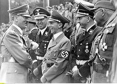 Hitler, Schaub and Goebbels in 1938. (via putschgirl)