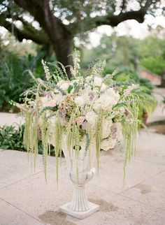 Large urns dripping in amaranthus! LOVE. Floral design: InesNaftali.com - Seen on http://www.StyleMePretty.com/2014/05/28/romantic-glamour-in-miami/  Photography: KTMerry.com