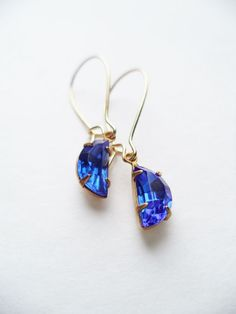 Hey, I found this really awesome Etsy listing at https://www.etsy.com/listing/215167295/vintage-earrings-half-moon-glass-dangles