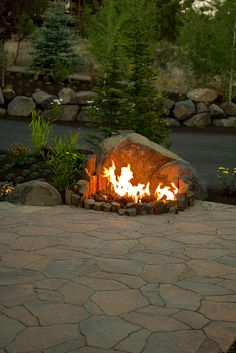 AWESOME firepit backed with broken boulder