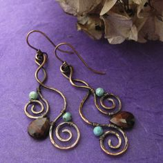 copper wirework scroll earrings with bead accents