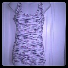 Multi color tank top zebra print tank top and the colors are purple blue and pink max rave  Tops Tank Tops