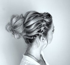 Waterfall braid with twisted messy bun. I like the way she created the bun. I could also do this style with a half-french or half-dutch braid, which might be easier...!