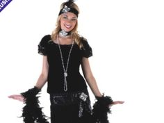 Velvet black outfit features tons of sequins and fringe, a drop waist, and a headband and choker with applique. $48.99