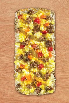 1 Flatout® Flatbread Artisan Thin Pizza Crust 2 eggs, lightly scrambled 1/2 cup Cheddar cheese 3 oz. sausage, cooked and crumbled 2 oz. yellow and red peppers, diced Place flatbread on a cookie sheet. Bake at 375 degrees for two minutes. Remove from oven. Top flatbread with cheese, scrambled egg, sausage and peppers. Return to Continue Reading...