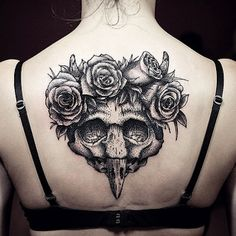 Rose and bird scull tattoo, reminds me of Roland and the Dark Tower