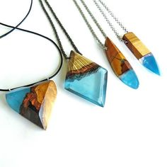 Blue resin and wood pendants handmade by WoodAllGood. #WoodAllGood