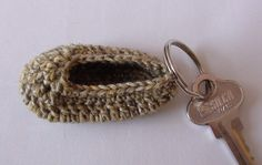 How to make a Crochet Baby Bootie Keyring Video Tutorial and Pattern at http://youtu.be/_DeQ6SNhSkg    Great for baby shower gifts!