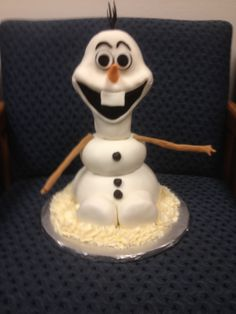 Olaf from Frozen - The large Olaf body was a vanilla pound cake with vanilla buttercream. The head was Rice Krispie Treats covered in chocolate and Marshmallow fondant. The four smaller Olaf's were all Rice Krispies Treats covered in chocolate and Marshmallow fondant.