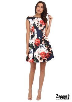 Blooms continue to flourish for fall! A charming and flirty floral Vince Camuto fit-and-flair dress is perfect for any special occasion. The bright blooms on a dark background is the perfect mix of moody and whimsy.
