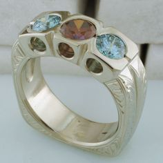 14kt white gold mothers ring Blue and red diamonds; engraved designs