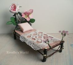 https://flic.kr/p/Husgii | Fairy bed with rose flowers | Handmade fairy bed in 1:12 scale out of tree branches decorated with flowers and leaves. Available here: www.revellosworld.de/produkt/feenbett-mit-rosa-blumen/