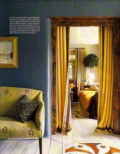 Aside from the wonderful fabric on the settee and the stenciling on the floor; love the shade of blue with the gold!