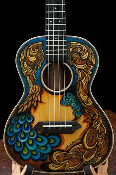 Nice combo of colors and designs. Handmade Ukulele by custom guitar builder Jay Lichty, artwork by Clark Hipolito Ukulele Art, Tenor Ukulele, Guitar Art, Cool Guitar, Guitar Logo, Custom Acoustic Guitars, Custom Guitars, Painted Ukulele, Painted Guitars