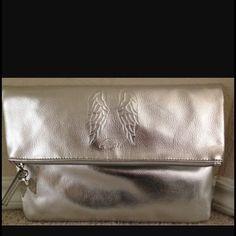 Victoria secret angel silver cosmetic bag This is a brand new with tag Victoria secret angel fold over cosmetic bag with a zipper in silver Victoria's Secret Accessories
