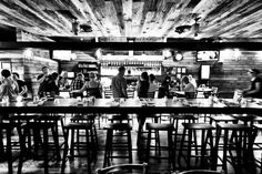 The long communal bar at the Industry Bar in Pennsport.