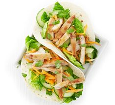 Fill soft flour tortillas with pan-fried chicken, lightly pickled cucumber and carrot for an Asian-style lunch or dinner. Bbc Good Food Recipes, Lunch Recipes, Gourmet Recipes, Dinner Recipes, Healthy Recipes, Chicken Wraps, Chicken Avocado Wrap, Pan Fried Chicken, Salmon And Rice