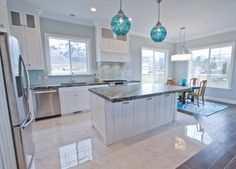 No wonder people like spending their holiday on a beach. Now, you can bring it to your home by implementing these coastal kitchen style ideas. Stock Kitchen Cabinets, Kitchen Tiles, New Kitchen, Kitchen Decor, Kitchen White, Awesome Kitchen, Kitchen Laminate, Laminate Counter, Granite Kitchen