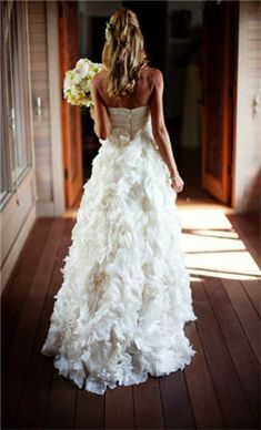 Ruffled, strapless wedding dress.