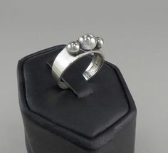 Modernist Silver Ring by E. Granit  Co. Finland.  This is exactly what Erik Granit is known for, simplistic but stunning designs.  This ring has three
