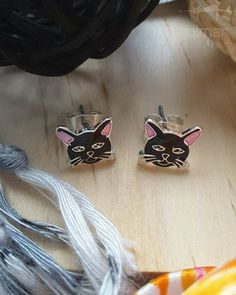 These cute black cat face silver plated stud earrings have been exclusively designed by Marilyn Grame. Hand-painted with black and pink enamels these earrings display the features of a playful black kitty with the inclusion of silver whiskers. Exquisite cat shaped cat jewelry. Free Express Shipping within Australia
