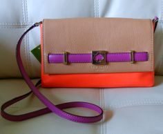Crisp Color, Graphic Prints and Playful Sophistication are Hallmarks of Kate Spade New York. The Houston Street Loula is a Tri Color Crossbody Handbag that Can also be used as a Clutch. Made out of Genuine Leather, Color Blocked in Sand Beige, Bright Orange and Deep Purple, and has a KS Logo Embl...