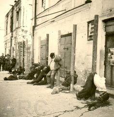 Occupied USSR lands: The Nazi firing squad has just finished with this group of hostages.