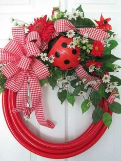 Wreath: garden hose and ladybug Wreath: garden hose and ladybug Christmas Wreaths For Front Door, Holiday Wreaths, Wreath Crafts, Diy Wreath, Monogram Wreath, Wreath Ideas, Wood Wreath, Lady Bug, Garden Hose Wreath