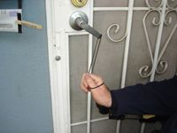 DO IT YOURSELF ENTRY --- PURPOSE: To enable an individual with limited grasp to opene a door. Form a loop large enough to fit over the door handle at one end of a length of parachute cord (available in hardware stores
