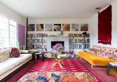 A living room packed with color, pattern & personality