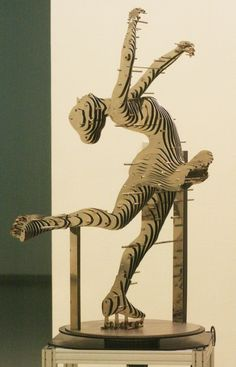 Skater - by Park Chan-Girl of Korea;  he uses pins to hold together pierced layers of precisely cut steel to form his sculptures