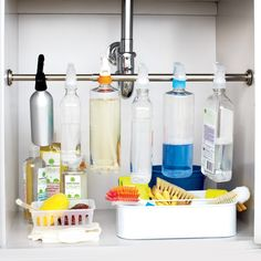 Chaos under your sink? Tame a crowd of spray bottles by installing a curtain rod across the cabinet. Suspend them by their spray triggers, and voila! Freed-up space for other bathroom or kitchen essentials. A heavy-duty tension rod will work, but a screw-mounted option is best if you have many (or particularly heavy) bottles. In-Tension rod, in Pewter, bedbathandbeyond.com.