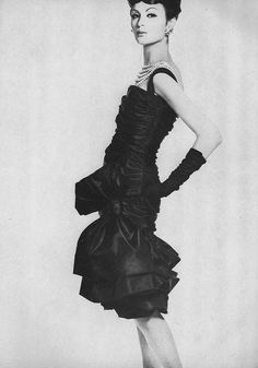 September Vogue 1959    A moulded shape of black taffeta with three whooshes about the knees, by Christian Dior. Photographed by Irving Penn.
