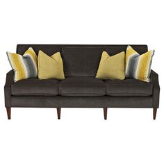 Showcasing track arms and welted details, this contemporary sofa adds a sleek touch to your living room or home library. Made in the USA.  ...