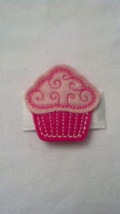 Pink Cupcake Felt Embellishment on a 2 inch snap clip covered in a grosgrain ribbon  Carlykins Boutique Baby Girl Hair Accessories by CarlykinsBoutique, $4.25