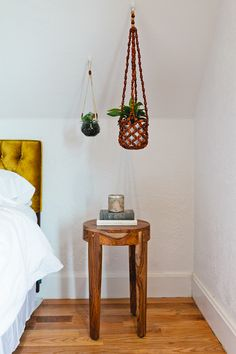attic rooms : hanging plants utilize that funny space created by a low slanted ceiling