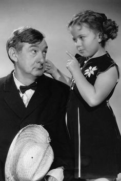 Shirley Temple with Slim Summerville. Rebecca of Sunnybrook Farm, 1938.