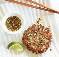 Fresh Tuna Burgers with Ginger & Cilantro - 1 lb. fresh sushi-grade tuna fillet   2 Tbs. chopped fresh cilantro   2 Tbs. finely chopped red onion or scallion   2 Tbs. mayonnaise   1 tsp. minced fresh ginger   1/2 tsp. minced fresh hot green or red chile, such as cayenne, Thai bird, or serrano   Kosher salt and freshly ground black pepper   2 Tbs. canola oil