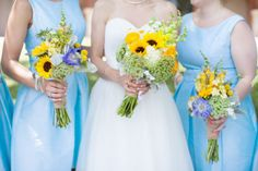 Leah's bridesmaid bouquets were made up of sunflowers, scabiosa, thistle, yellow snap dragons, white stock, dusty miller, Queen Anne's lace, and craspedia. Their bouquets were wrapped in burlap. Flowers by Dorothy McDaniel's Flower Market