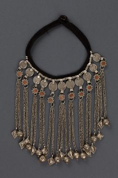 Yemen | Necklace; silver and coral. Consists of 8 pendants, each hanging from an Islamic silver coin | ca. early 1900s |
