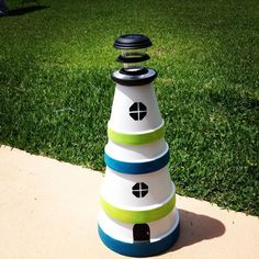 Image on The Owner-Builder Network  http://theownerbuildernetwork.co/easy-diy-projects/diy-clay-pot-lighthouse/