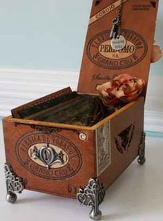 Altered art and assemblage can take on many forms. Building an assemblage or shrine box is a creative project that combines infinite . Cigar Box Diy, Cigar Box Crafts, Altered Cigar Boxes, Cigar Art, Altered Tins, Altered Bottles, Diy Box, Altered Art, Altered Books